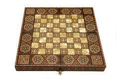 Antique Chess Board. Antique foldable wooden chessboard with 'mother of pearl' squares set in Stock Photo