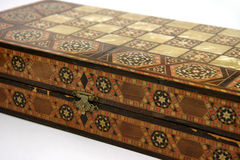 Antique Chess Board. Antique foldable wooden chessboard with 'mother of pearl' squares set in royalty free stock images