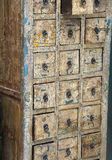 Antique chest of drawers with many drawers in wood Royalty Free Stock Photos