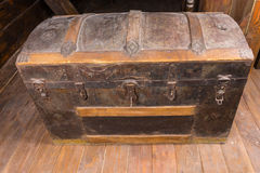 Antique Chest with Key in Lock on Deck of Ship Stock Image