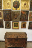 An antique chest and old icons on the wall Stock Photo