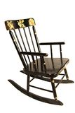 Antique Child's Rocking Chair. Early 20th century black enameled, stenciled child's rocking chair Stock Images