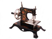 Antique Child's Toy Sewing Machine. Highly decorated black all steel antique child's crank toy sewing machine Royalty Free Stock Photos
