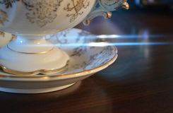 An antique china cup and saucer stock photo