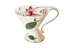 Antique China tea cup and saucer with leaves and delicate flowers Royalty Free Stock Image