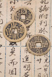Antique chinese book page and coin Royalty Free Stock Photography