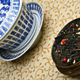 Antique chinese cup and a blend of tea leaves. Royalty Free Stock Photography