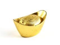 Antique chinese gold ingot isolated on white background, chinese characters on gold ingot means making plenty of money. Close-up antique chinese gold ingot Royalty Free Stock Image