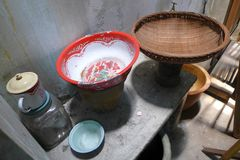 Antique chinese household items. A photograph showing some very old fashioned house hold items inside a Chinese style farm house. Objects displayed include stock image