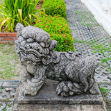 Antique Chinese Lion statue. In the park.Antique ballast Royalty Free Stock Image