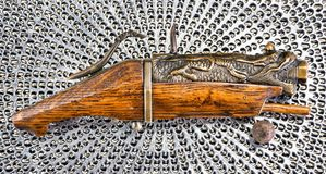 Antique Chinese Matchlock Pistol. royalty free stock photos