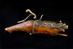Antique Chinese Matchlock Pistol. stock images