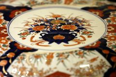 Antique asian china decor plate detail. Antique chinese porcelain flower pattern Stock Photography