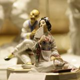Antique asian pair china statue. Antique chinese porcelain man and woman figures Stock Image