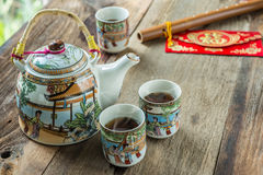 Antique Chinese tea set on wooden table Stock Image