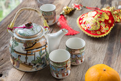 Antique Chinese tea set on wooden table Stock Images
