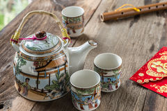 Antique Chinese tea set on wooden table Stock Photography