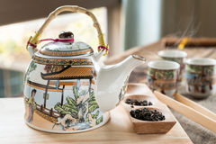 Antique Chinese tea set on wooden table Stock Photo