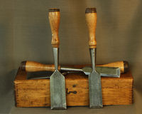 Antique Tools. A still life image of antique wood chisels (circa 1900) with case Royalty Free Stock Image