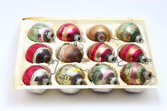 Antique Christmas assorted striped ornaments set. Vintage antique set of faded striped Christmas ornaments from the 1960s Stock Photo