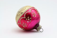 Antique Christmas pink and gold ornament with faded glitter Stock Photos