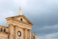 Antique church and clock. With grey sky Stock Images