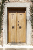 Antique church entrance wooden door with crosses. Crete. Greece Stock Photography