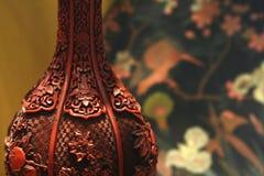 Antique cinnabar vase detail background. Antique chinese cinabar vase background Stock Photography