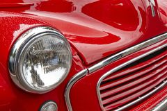 Antique classic red car front part detail. Vintage background Royalty Free Stock Images