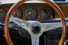 Antique classic wood steering wheel and dashboard in German vintage car stock photography