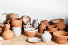 Antique clay crockery set  on white background Stock Photos