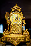 Antique clock. Wedding rings on arrows of an old watch Royalty Free Stock Photography