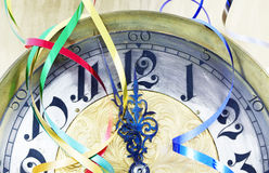 Antique clock. With New Year ribbons, gold and silver decorations Stock Images