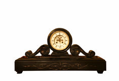 Antique clock. Antique black clock elaborately decorated Stock Photo