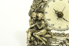 Antique clock. The antique clock with a couple on it stock image