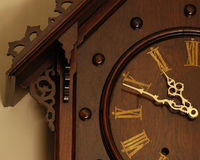 Antique clock. Refurbished antique clock Stock Photography