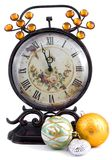 Antique clock. With New Year's spheres Stock Photos