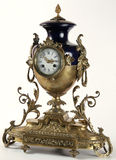 Antique clock. An antique clock with bronze animal and floral forms stock photo