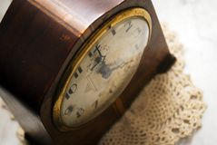 Antique clock. Top down view of an antique clock on a marble top table stock photos
