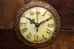 Antique clock. On leather background Royalty Free Stock Photo