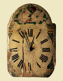 Antique clock. Decorated by flower patterns Royalty Free Stock Photography