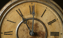 Antique clock. An antique clock shows eleven o'clock royalty free stock images
