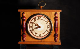 Antique clock. On a black background Stock Photos