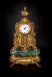 Antique clock on black background Stock Photo