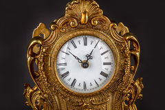 Antique clock on black background Royalty Free Stock Photography