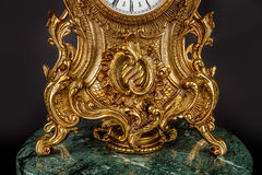 Antique clock on black background Stock Photography