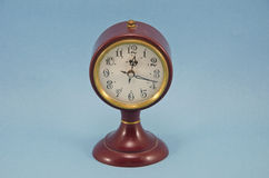 Antique clock on blue background Royalty Free Stock Images