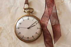 Antique clock. And   brown envelope Royalty Free Stock Images
