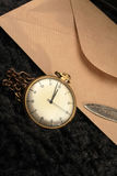 Antique clock. And   brown envelope Stock Images