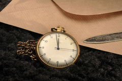 Antique clock. And   brown envelope Stock Photography